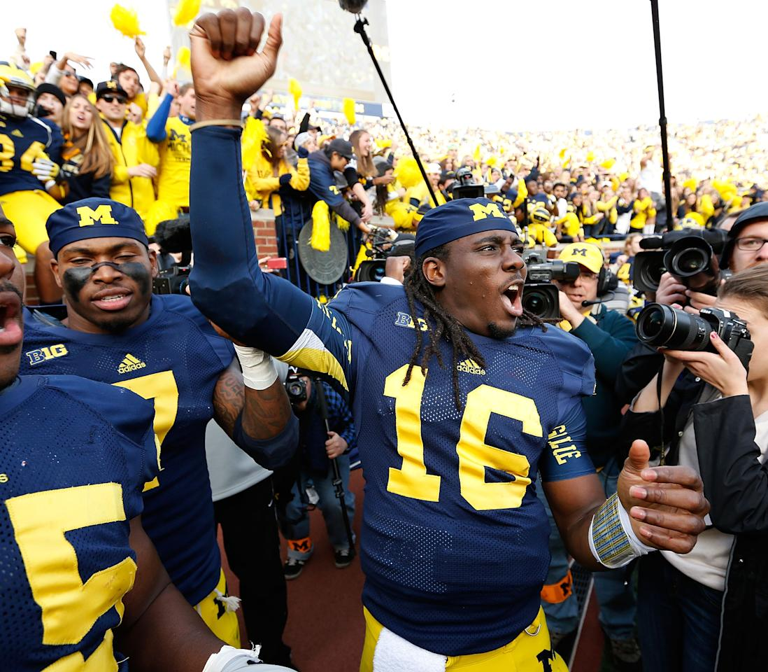 ANN ARBOR, MI - NOVEMBER 17:  Denard Robinson #16 of the Michigan Wolverines celebrates a 42-17 victory over the Iowa Hawkeyes Michigan Stadium on November 17, 2012 in Ann Arbor, Michigan. (Photo by Gregory Shamus/Getty Images)