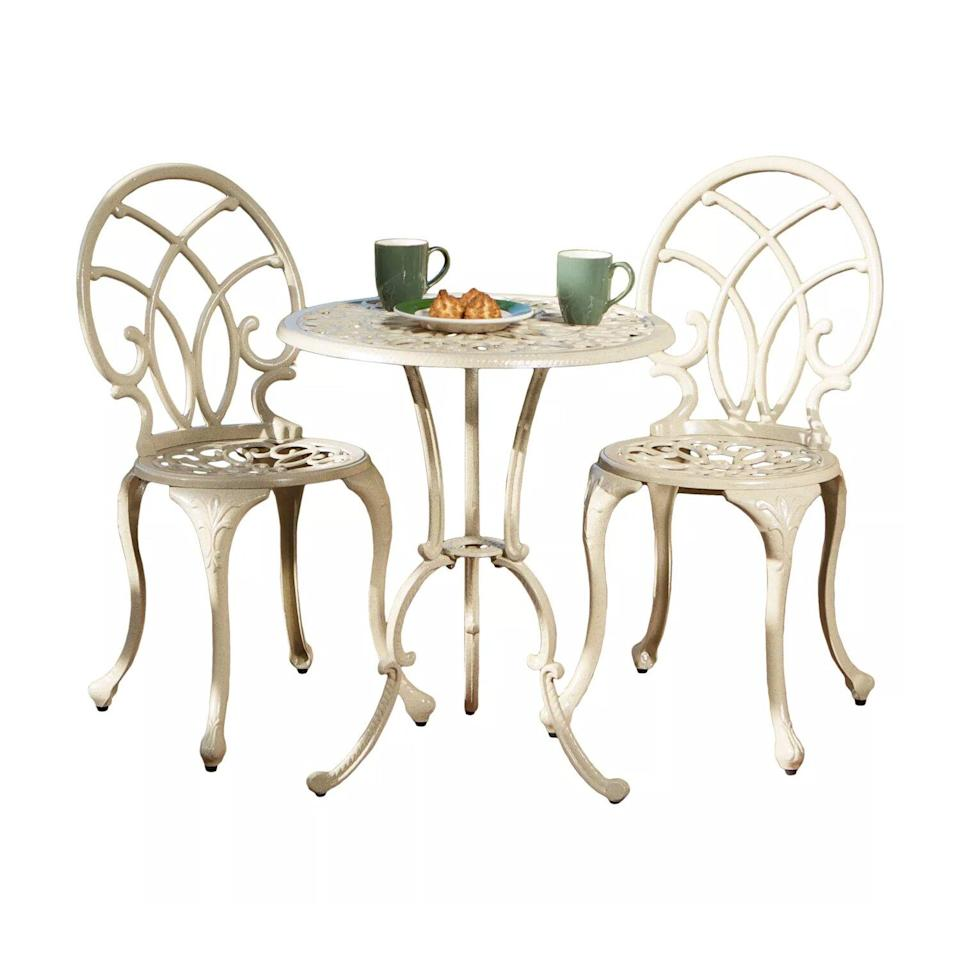 three-piece white bistro set with coffee cups and food