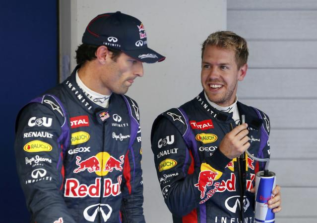 Red Bull Formula One driver Sebastian Vettel of Germany (R) smiles at teammate Red Bull Formula One driver Mark Webber of Australia after the qualifying session for the Korean F1 Grand Prix at the Korea International Circuit in Yeongam, October 5, 2013. Formula One championship leader Vettel will start Sunday's Korean Grand Prix on pole position for Red Bull with Lewis Hamilton's Mercedes alongside on the front row. REUTERS/Kim Hong-Ji (SOUTH KOREA - Tags: SPORT MOTORSPORT F1 TPX IMAGES OF THE DAY)