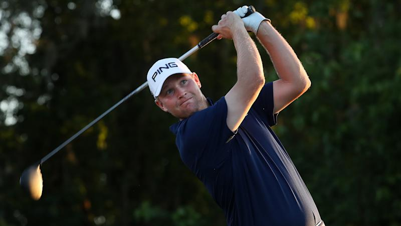 Mullinax in contention despite concussion after being hit with ball during pro-am