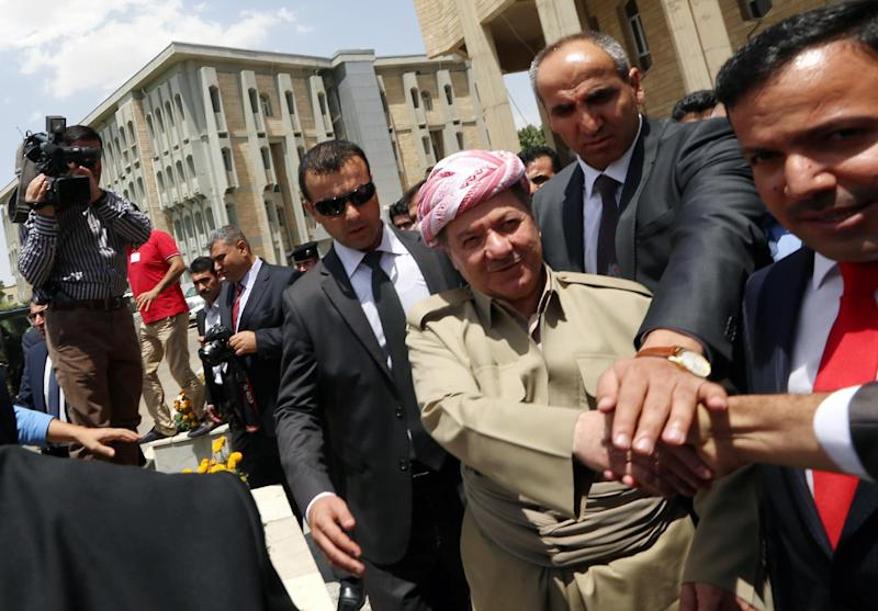 The president of Iraq's autonomous Kurdistan region, Massud Barzani (centre) is greeted by supporters as he arrives for a session of the Kurdistan parliament in Arbil, on July 3, 2014 (AFP Photo/Safin Hamed)