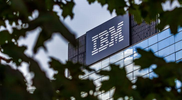 Photo of IBM (IBM) building as seen through the canopy of a tree. IBM logo is in large letters on side of building.