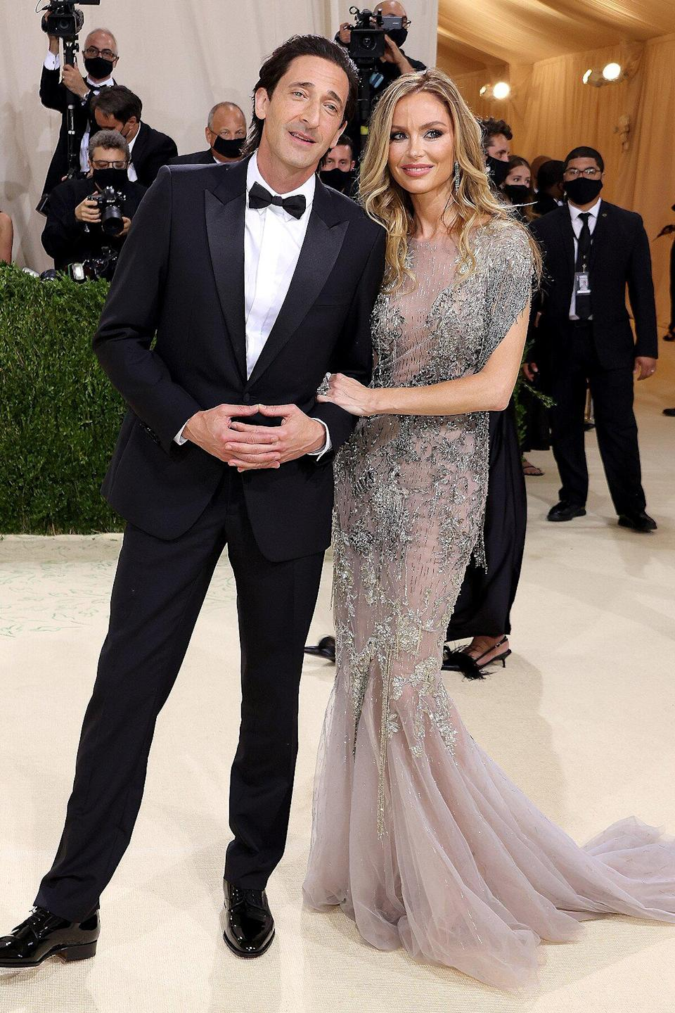 Adrien Brody and Georgina Chapman attend The 2021 Met Gala Celebrating In America: A Lexicon Of Fashion at Metropolitan Museum of Art on September 13, 2021 in New York City.