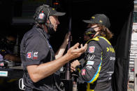 Colton Herta, right, talks with his father Bryan Herta during practice for the Indianapolis 500 auto race at Indianapolis Motor Speedway in Indianapolis, Friday, May 21, 2021. (AP Photo/Michael Conroy)