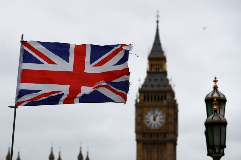 A Union flag flutters near the Houses of Parliament in London