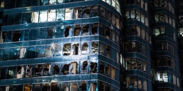 Windows of a commercial building damaged by Typhoon Mangkhut on September 16, 2018 in Hong Kong. City officials raised the storm alert to T10, its highest level.