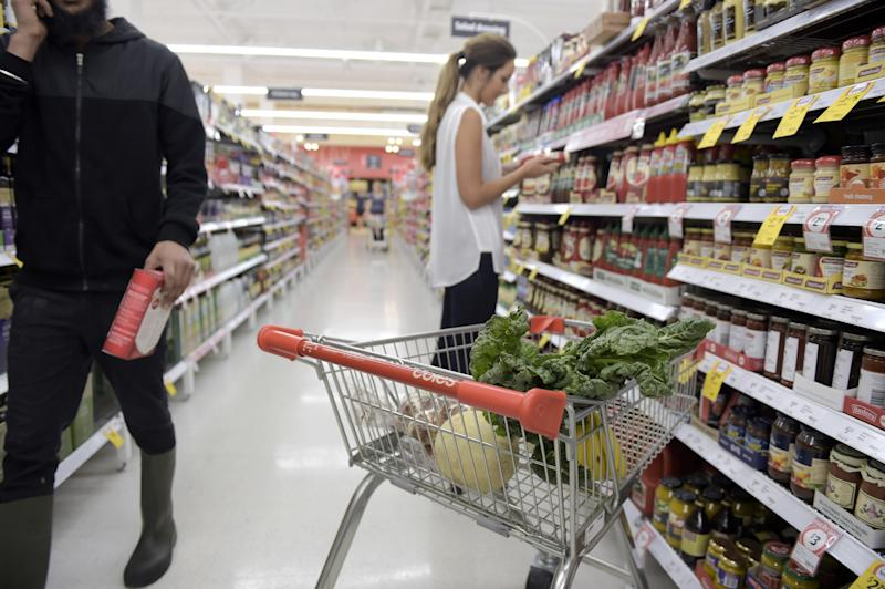 A shopper seen look at product labels in Coles.