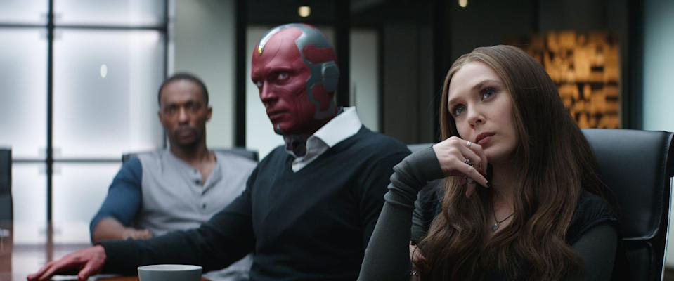 "Vision (Paul Bettany, center) and Wanda Maximoff (Elizabeth Olsen) hung with Avengers like Sam Wilson (Anthony Mackie) in ""Captain America: Civil War."""