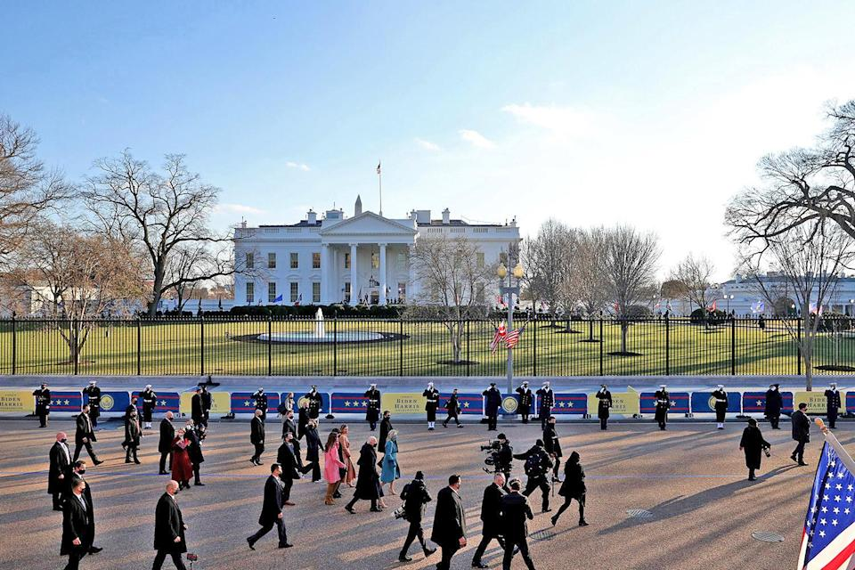 <p>Biden's family walks along the shortened parade route outside the White House in this zoomed-out shot. </p>
