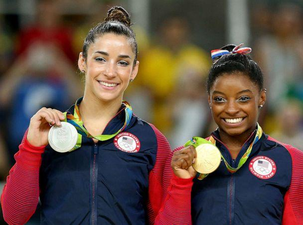 PHOTO: Alexandra Raisman, left, and Simone Biles of the U.S. pose for photographs on the podium at the medal ceremony for the Women's Floor on Day 11 of the Rio 2016 Olympic Games at the Rio Olympic Arena on Aug. 16, 2016 in Rio de Janeiro. (Alex Livesey/Getty Images, FILE)