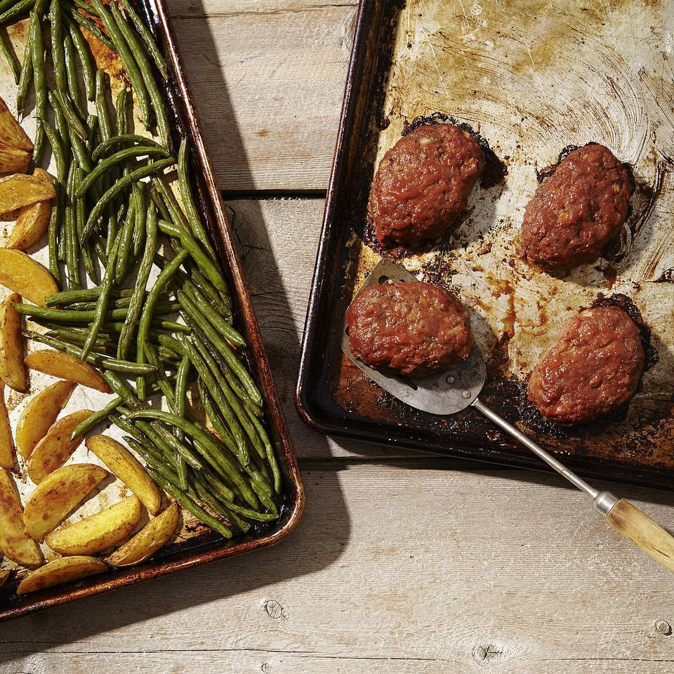 <p>This healthy meatloaf recipe and side dishes are all made in the oven on two sheet pans so that everything's ready for the dinner table at the same time. The potatoes go into the oven first to start roasting while the mini meatloaves and green beans are prepped and added to the oven partway through.</p>