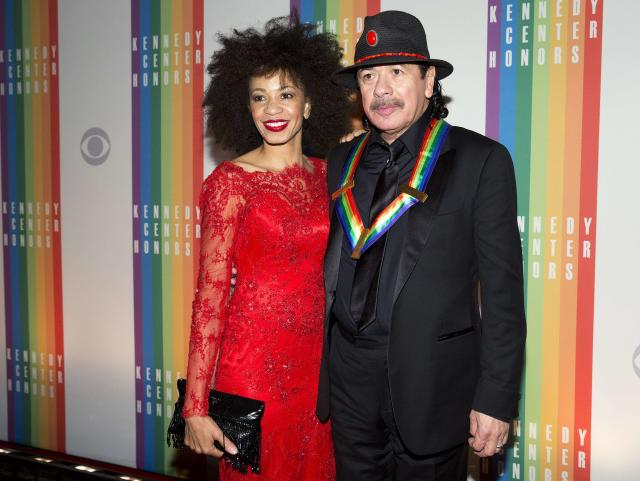 Kennedy Center Honoree, musician Carlos Santana, and his wife Cindy Blackman arrive for the Kennedy Center Honors in Washington December 8, 2013. REUTERS/Joshua Roberts (UNITED STATES - Tags: ENTERTAINMENT)