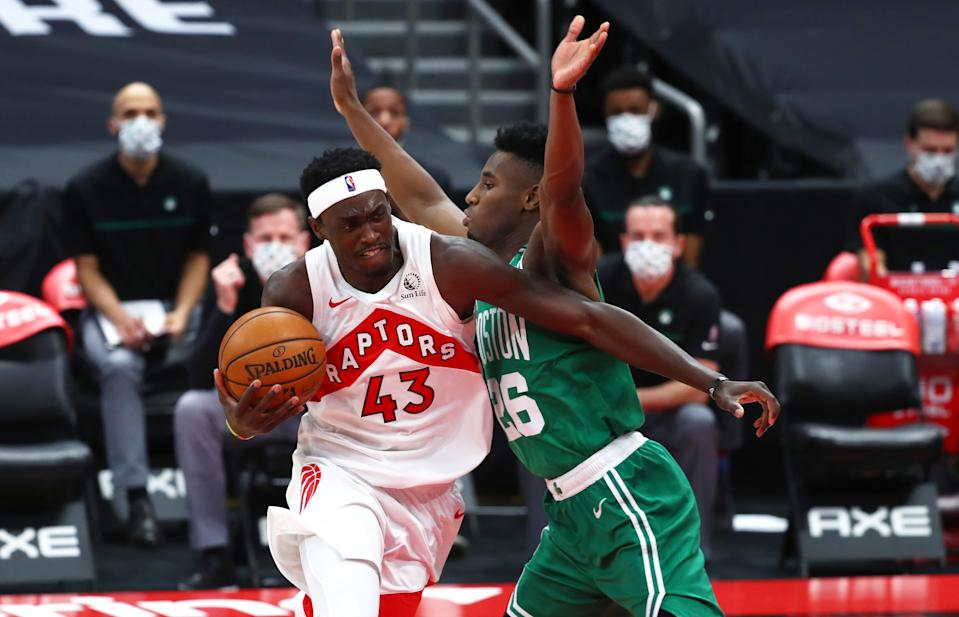 Jan 4, 2021; Tampa, Florida, USA; Toronto Raptors forward Pascal Siakam (43) drives to the basket against Boston Celtics forward Aaron Nesmith (26) during the second quarter at Amalie Arena. Mandatory Credit: Kim Klement-USA TODAY Sports