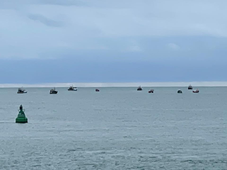 Boats are seen in the only channel that allows access to the harbour, in St Helier, Jersey. Source: Reuters