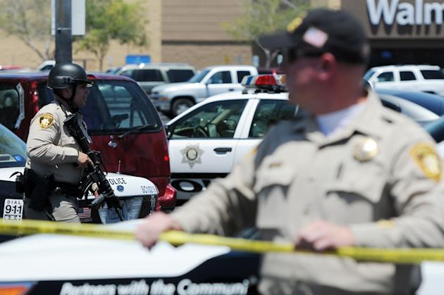 Las Vegas police on the scene of the June 2014 deadly rampage carried out by extremists Jared and Amanda Miller. (AP Photo/Las Vegas Review-Journal, Eric Verduzco)