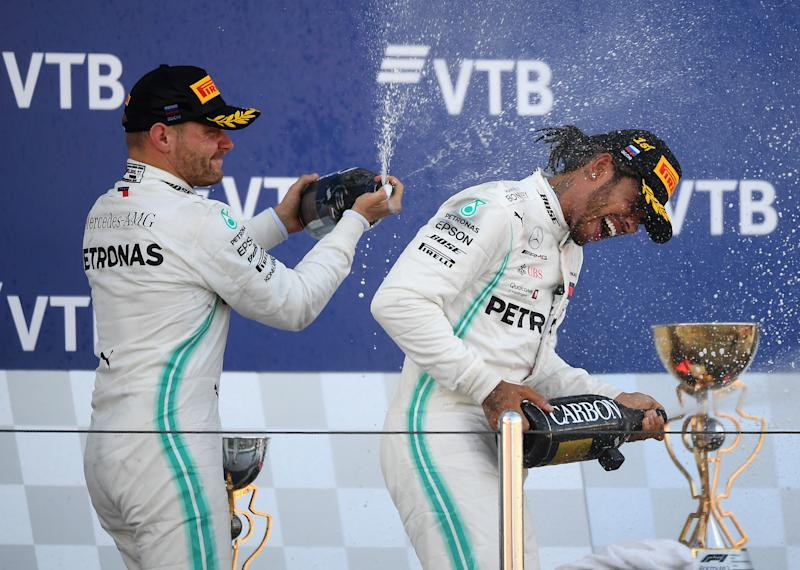 SOCHI, RUSSIA - SEPTEMBER 29: Race winner Lewis Hamilton of Great Britain and Mercedes GP and second placed Valtteri Bottas of Finland and Mercedes GP celebrate on the podium during the F1 Grand Prix of Russia at Sochi Autodrom on September 29, 2019 in Sochi, Russia. (Photo by Clive Mason/Getty Images)