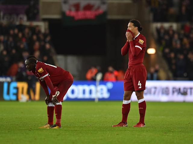 "Liverpool players Sadio Mane (left) and <a class=""link rapid-noclick-resp"" href=""/soccer/players/380942/"" data-ylk=""slk:Virgil van Dijk"">Virgil van Dijk</a> rue a loss at Swansea. (Getty)"