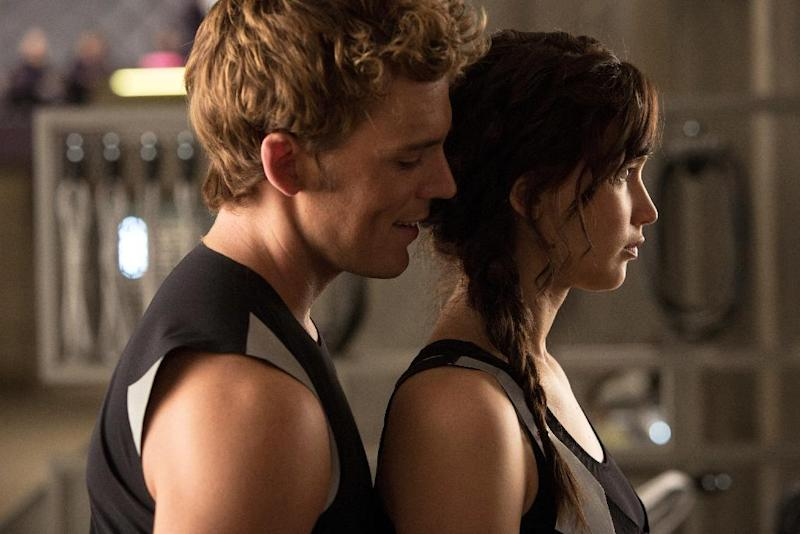 """This film image released by Lionsgate shows Sam Claflin, left, and Jennifer Lawrence in a scene from """"The Hunger Games: Catching Fire."""" (AP Photo/Lionsgate, Murray Close)"""