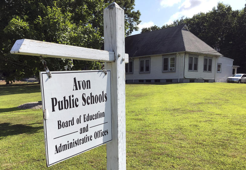 This July 12, 2019, photo shows the board of education offices in Avon, Conn. A denial of a service cyberattack overwhelmed the Avon school district's technology systems in late 2017 and brought to a halt instruction built around access to the internet. The FBI said cyberattacks have become common at schools, which are attractive targets because they hold sensitive data and provide critical public services. Malicious use of the data could lead to bullying, tracking and identity theft, the agency said. (AP Photo/Michael Melia)
