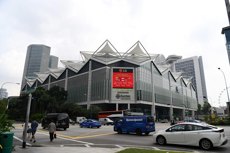 "This photo taken on November 10, 2018 shows people driving past the Suntec City convention and exhibition centre, the venue of the upcoming 33rd Association of Southeast Asian Nations (ASEAN) Summit, in Singapore. - World leaders will push for the rapid completion of a massive, China-backed trade deal that excludes the US at the ASEAN summit this week, in a rebuke to rising protectionism and Donald Trump's ""America First"" agenda. (Photo by Roslan RAHMAN / AFP) / TO GO WITH ASEAN-summit-trade-economy,ADVANCER by Martin Abbugao (Photo credit should read ROSLAN RAHMAN/AFP via Getty Images)"