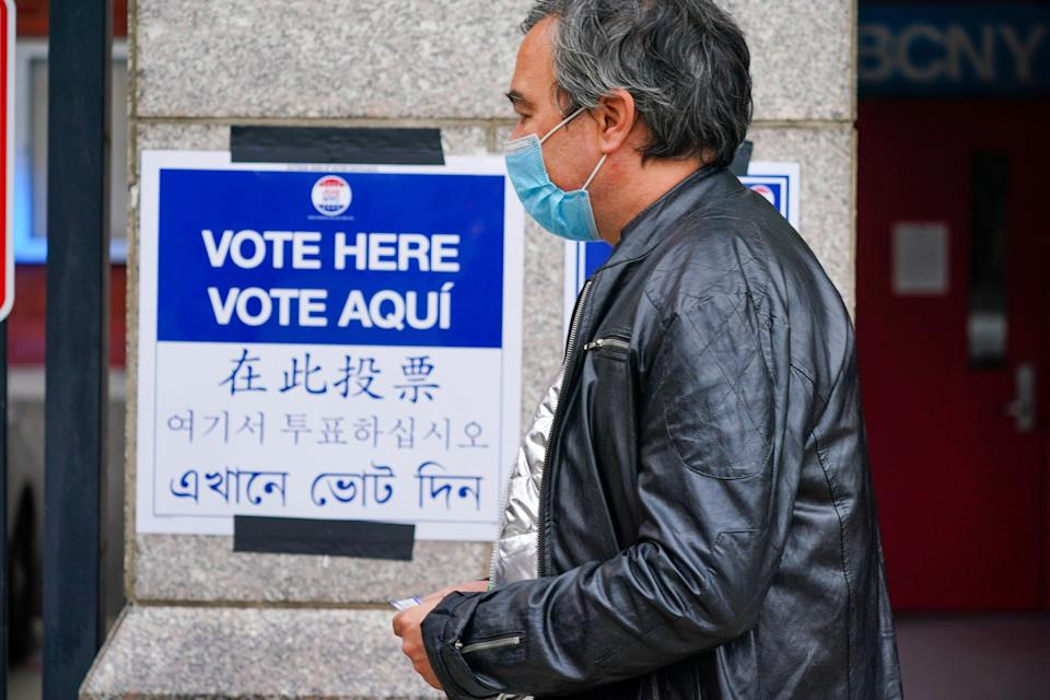 A sign in multiple languages at an early voting site in New York City on Oct. 24, 2020. AAPI advocates say providing resources in different languages is helpful, but not enough to engage voters. (Photo: John Nacion/STAR MAX/IPx)
