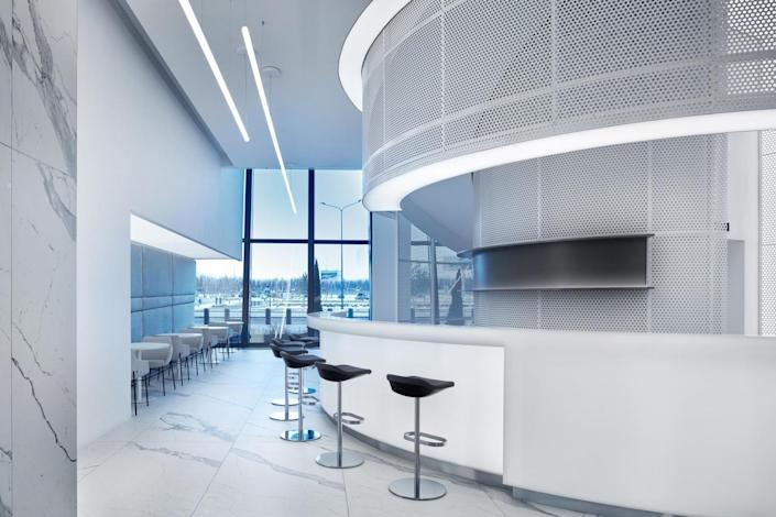 The bar area inside the new VIP lounge is similarly minimalistic for a totally space-age feel.