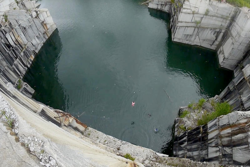 Cliff diver makes huge 34-metre jump into flooded quarry in Vermont