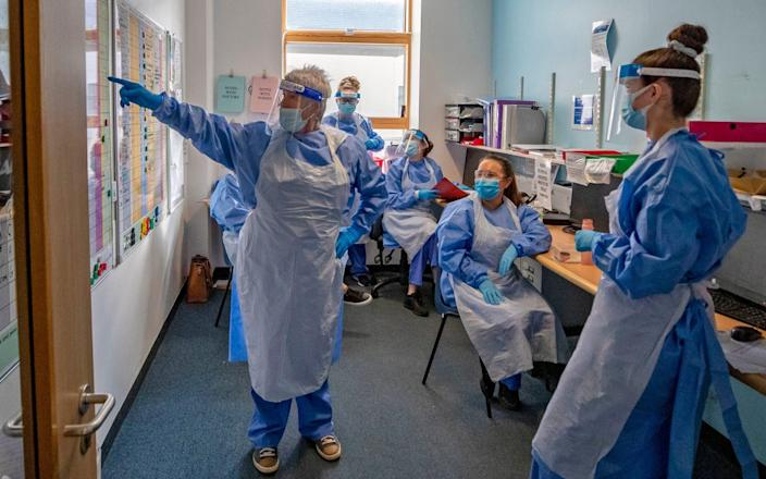 Nurses hold a meeting on one of five Covid-19 wards at Whiston Hospital in Merseyside where patients are taken to recover from the virus - Peter Byrne/PA