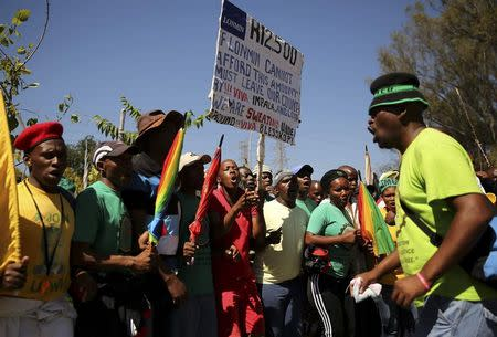 Striking miners chant slogans as they march to Lonmin's head quarters in Johannesburg