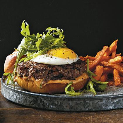 """<p>Between the beef, egg, cheese, mushrooms, and truffle oil, <a href=""""https://www.myrecipes.com/cooking-method/grilled-recipes/easy-burger-recipes"""" rel=""""nofollow noopener"""" target=""""_blank"""" data-ylk=""""slk:this burger"""" class=""""link rapid-noclick-resp"""">this burger</a> is an absolute umami bomb, exploding with meaty, savory flavor. Chopped, sautéed mushrooms in the burger mixture add low-fat moisture to the lean beef as it cooks.</p>"""