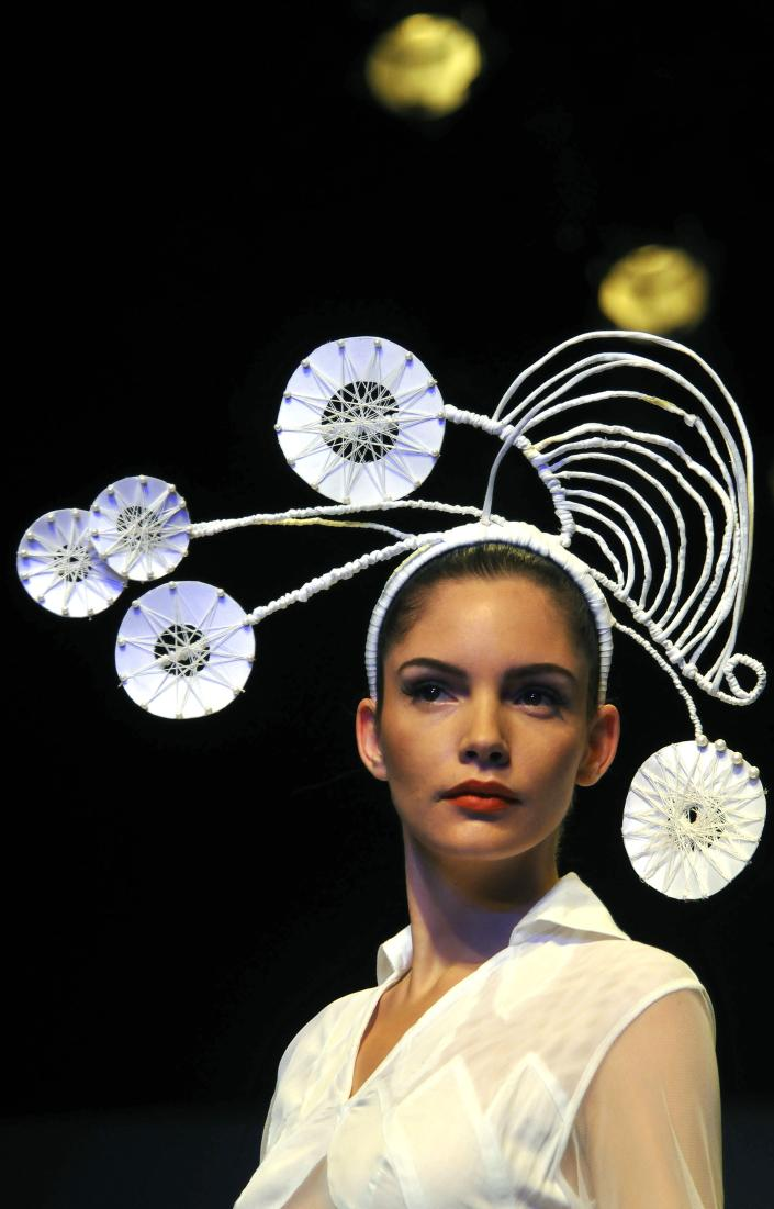 A model displays a creation by Rahul Singh at the Wills Lifestyle India Fashion Week Spring Summer 2012 in New Delhi, India, Tuesday, Oct. 11, 2011. (AP Photo/Tsering Topgyal)