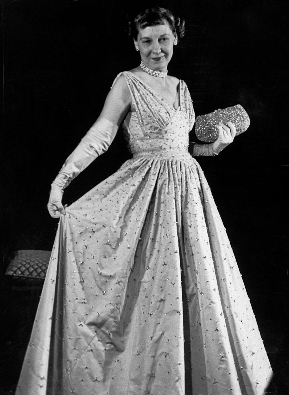 Mamie Eisenhower sported a rose-hued taffeta gown, which was designed by Nettie Rosenstein and featured more than 2,000 hand-embroidered rhinestonesThe LIFE Picture Collection via