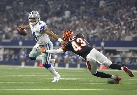 Aug 18, 2018; Arlington, TX, USA; Dallas Cowboys quarterback Dak Prescott (4) breaks the tackled of Cincinnati Bengals defensive back George Iloka (43) in the second quarter at AT&T Stadium. Mandatory Credit: Tim Heitman-USA TODAY Sports