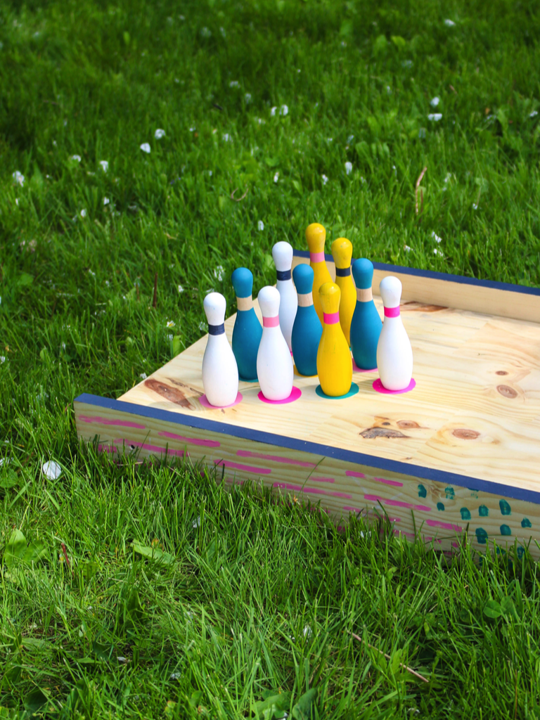 """<p>Your kids will want to spend hours outdoors with this cute DIY bowling idea. It's actually pretty easy to build! </p><p><strong>Get the tutorial at <a href=""""http://www.cloudydaygray.com/2016/05/backyard-bowling-with-ehow.html"""" rel=""""nofollow noopener"""" target=""""_blank"""" data-ylk=""""slk:Cloudy Day Gray"""" class=""""link rapid-noclick-resp"""">Cloudy Day Gray</a>.</strong></p><p><a class=""""link rapid-noclick-resp"""" href=""""https://www.amazon.com/BLACK-DECKER-BDEQS300-Orbital-Actuati/dp/B00OJWLVM6/?tag=syn-yahoo-20&ascsubtag=%5Bartid%7C2164.g.36687460%5Bsrc%7Cyahoo-us"""" rel=""""nofollow noopener"""" target=""""_blank"""" data-ylk=""""slk:SHOP ELECTRIC SANDERS"""">SHOP ELECTRIC SANDERS</a></p>"""
