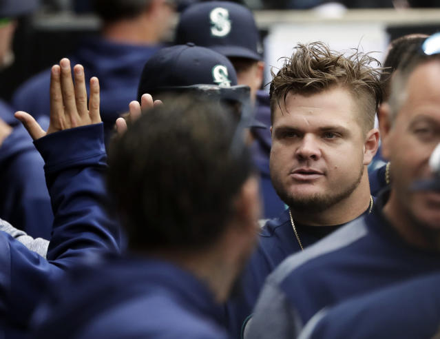 Seattle Mariners' Daniel Vogelbach, right, celebrates with teammates in the dugout during the third inning of a baseball game against the Chicago White Sox in Chicago, Sunday, April 7, 2019. Seattle Mariners' Daniel Vogelbach hit a three-run double. (AP Photo/Nam Y. Huh)