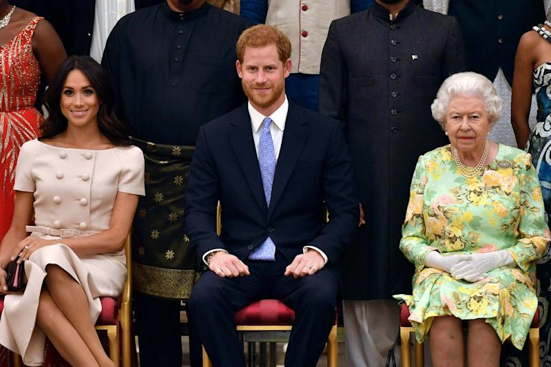 Queen Elizabeth, Prince Harry and Meghan, Duchess of Sussex: AP