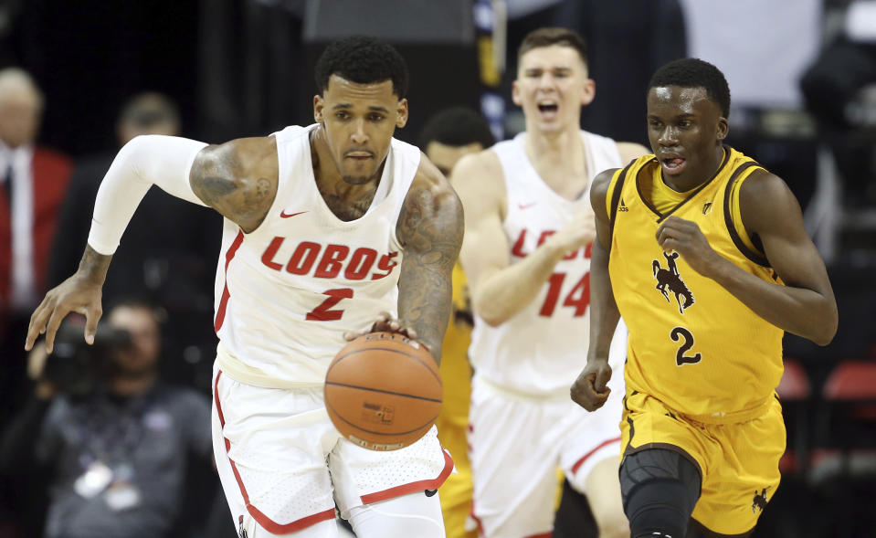 Wyoming's AJ Banks, right, defends as New Mexico's Corey Henson brings the ball up during the second half of an NCAA college basketball game in the Mountain West Conference men's tournament Wednesday, March 13, 2019, in Las Vegas. (AP Photo/Isaac Brekken)