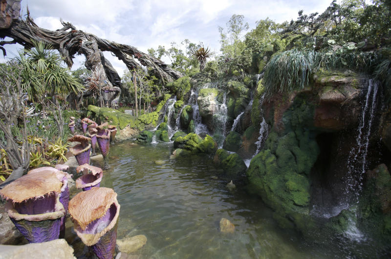 Landscaping consisting of real Earth plant species mixed with sculpted Pandora artificial flora is surrounded by ponds and gentle waterfalls. (AP Photo/John Raoux)