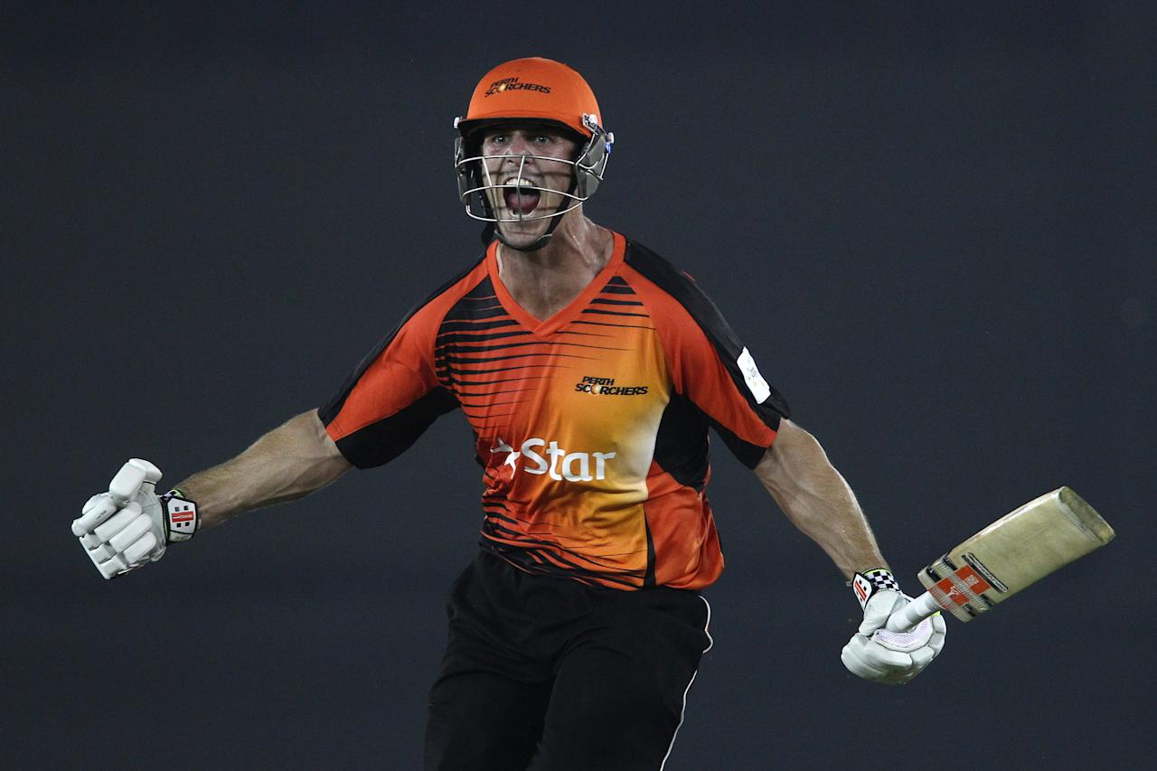 Mitchell Marsh of the Perth Scorchers celebrates after hitting a six off the final ball to beat Dolphins during match 4 of the Oppo Champions League Twenty20 between the Dolphins and the Perth Scorchers held at the Punjab Cricket Association Stadium, Mohali, India on the 20th September 2014  Photo by:  Shaun Roy / Sportzpics/ CLT20   Image use is subject to the terms and conditions as laid out by the BCCI/ CLT20.  The terms and conditions can be downloaded here:  https://ec.yimg.com/ec?url=http%3a%2f%2fsportzpics.photoshelter.com%2fgallery%2fCLT20-Image-Terms-and-Conditions-2014%2fG0000IfNJn535VPU%2fC0000QhhKadWcjYs&t=1490779087&sig=aoh6OsmrUcGMJl34ROWVDA--~C