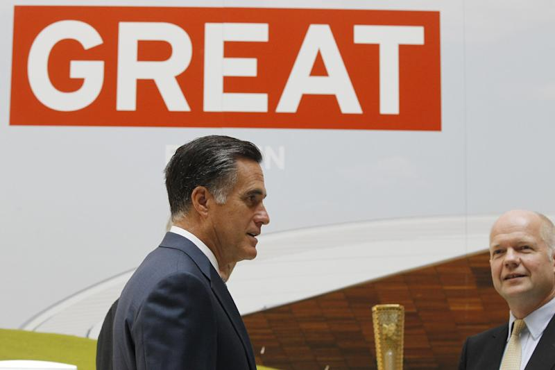 CORRECTS SPELLING OF PAVILLION - Republican presidential candidate and former Massachusetts Gov. Mitt Romney tours the GREAT Pavillion Exhibit with British Foreign Secretary William Hague in London, Thursday, July 26, 2012. (AP Photo/Charles Dharapak)