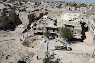A general view shows a hole in the ground filled with water in a damaged site after airstrikes on the rebel held Tariq al-Bab neighbourhood of Aleppo, Syria September 24, 2016. REUTERS/Abdalrhman Ismail