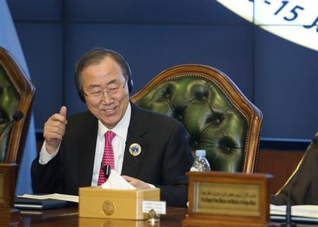UN Secretary-General Ban gives a thumbs up sign at the end of a conference in Kuwait