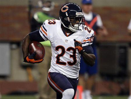 FILE PHOTO: Devin Hester carries the ball against the Detroit Lions during the first half of their NFL football game in Detroit, Michigan December 30, 2012. REUTERS/Rebecca Cook