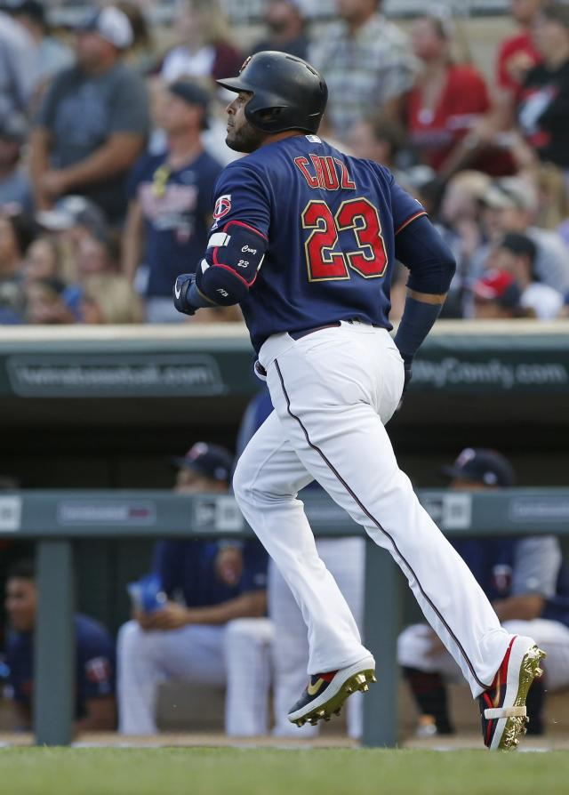 Minnesota Twins' Nelson Cruz watches his solo home run off Oakland Athletics pitcher Brett Anderson as he heads to first base in the first inning of a baseball game Saturday, July 20, 2019, in Minneapolis. (AP Photo/Jim Mone)
