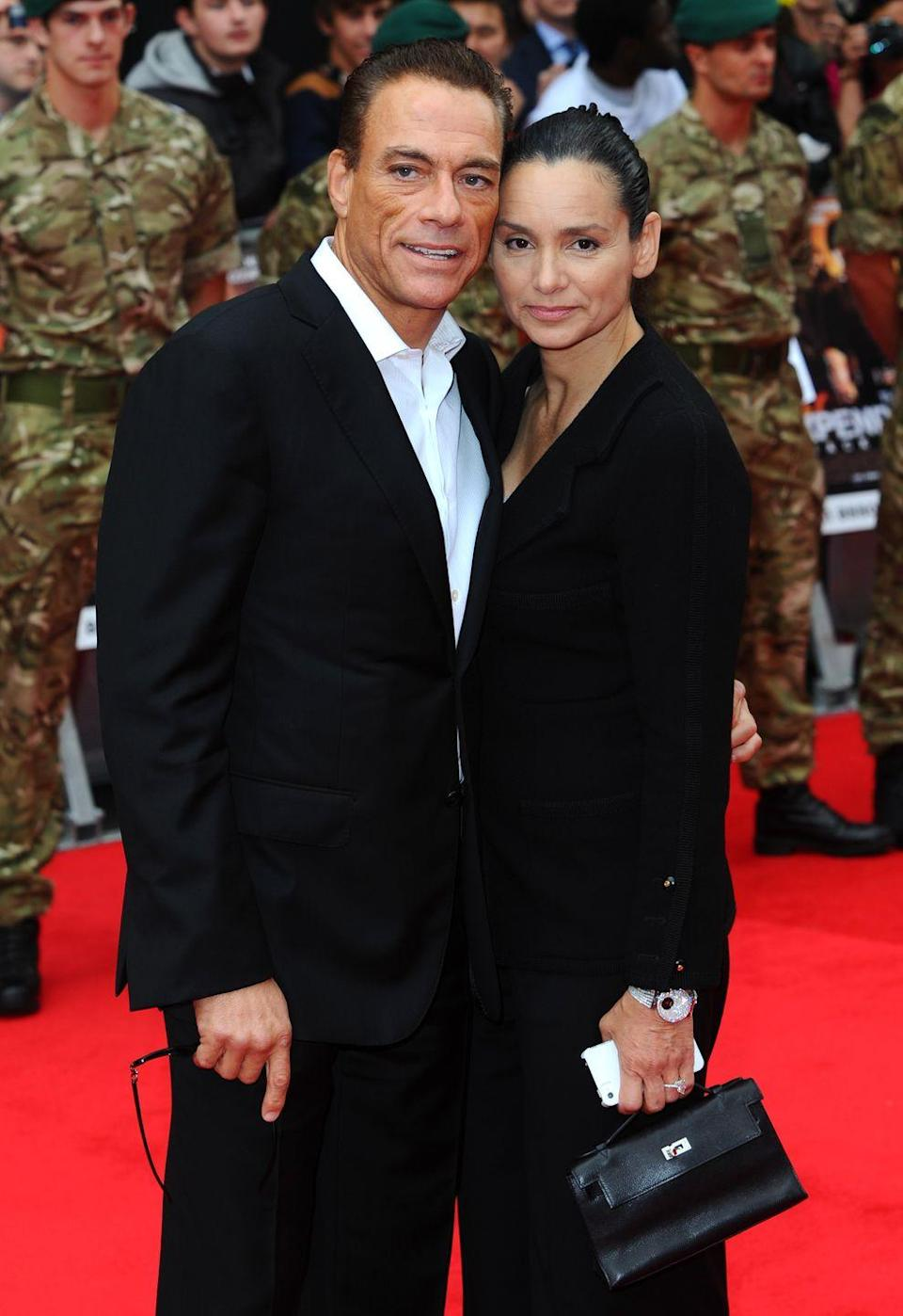 """<p>Jean-Claude Van Damme met bodybuilder Gladys Portugues at the height of his fame in the mid-'80s. They married in 1987, but divorced in 1992. After marrying and divorcing actress Darcy LaPier, Jean-Claude reunited with Gladys and they remarried in 1999. For the last 25 years, the couple has had their ups and downs. Gladys even <a href=""""https://www.dailymail.co.uk/tvshowbiz/article-3104862/Jean-Claude-Van-Damme-says-divorce-claims-s-reconciled-wife-Gladys-Portugues-s-married-divorced-remarried.html"""" rel=""""nofollow noopener"""" target=""""_blank"""" data-ylk=""""slk:filed for divorce in 2015"""" class=""""link rapid-noclick-resp"""">filed for divorce in 2015</a>, but later called it off, and they've remained together.</p>"""
