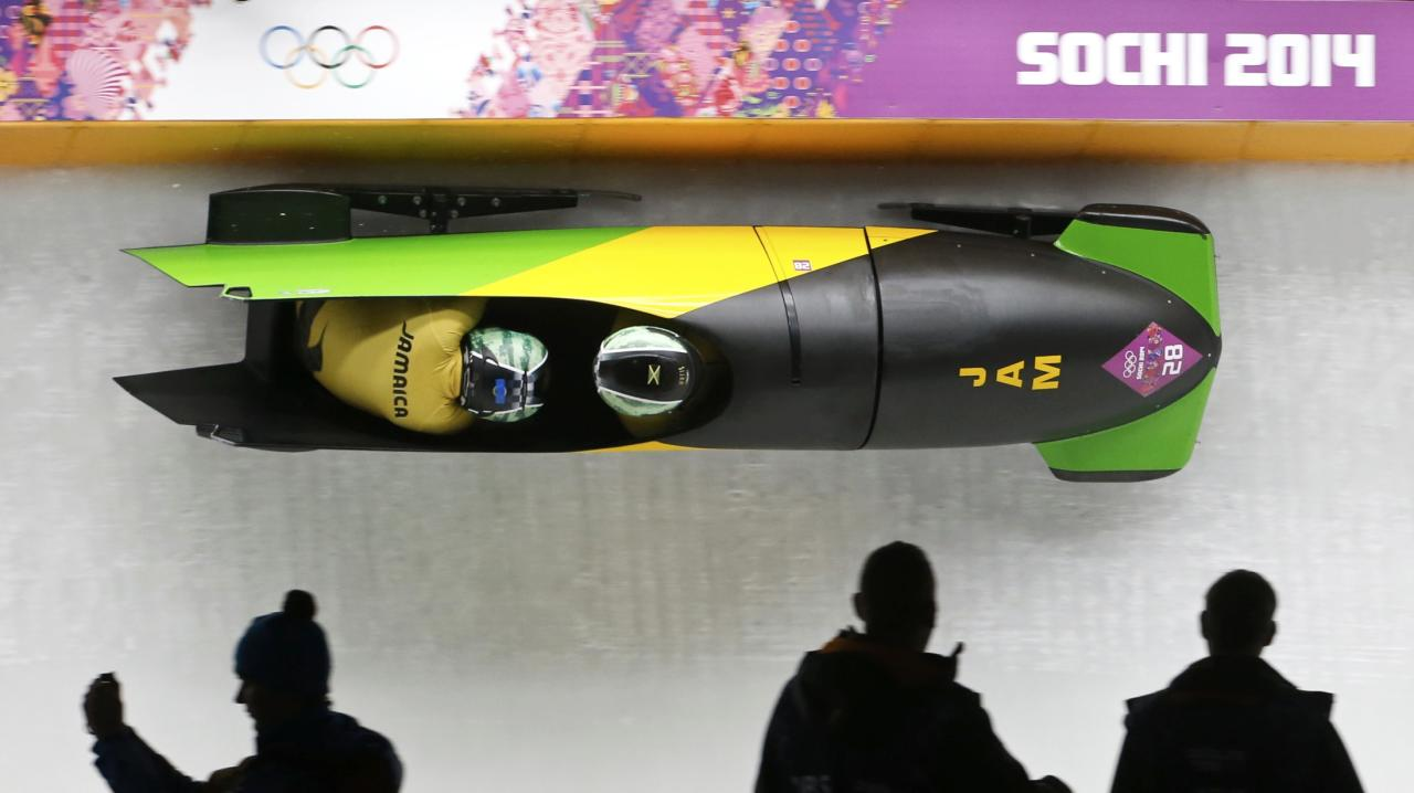 Jamaica's Winston Watts and Marvin Dixon speed down the track during the two-man bobsleigh event at the 2014 Sochi Winter Olympics, at the Sanki Sliding Center in Rosa Khutor February 16, 2014. REUTERS/Fabrizio Bensch (RUSSIA - Tags: SPORT BOBSLEIGH OLYMPICS)