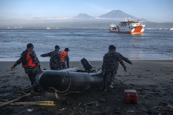 Indonesian Navy personnel prepare for a search rescue operation for victims of the sinking ferry KMP Yunice near Gilimanuk Port on Bali Island, Indonesia, Wednesday, June 30, 2021. Rescuers on Wednesday were searching for people missing in rough seas overnight. (AP Photo/Fauzy Chaniago)