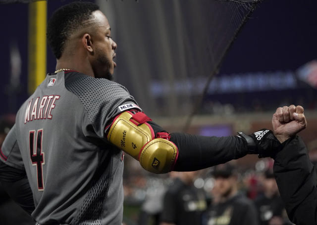 Arizona Diamondbacks' Ketel Marte is congratulated by a teammate as he returns to the dugout after his solo home run against the San Francisco Giants during the fifth inning of a baseball game in San Francisco, Tuesday, Aug. 27, 2019. (AP Photo/Tony Avelar)