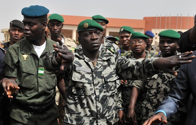 Malian military junta leader Amadou Sanogo (centre) who led the 2012 coup against then president Amadou Toumani Toure stood trial for murder and collusion over the massacre of soldiers who opposed the takeover