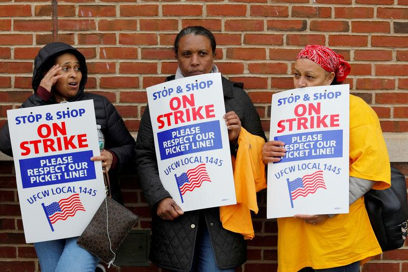 FILE PHOTO: Striking workers gather outside a Stop & Shop store following a speech by former U.S. Vice President Joe Biden in Boston